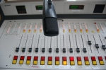 Imagine you are standing in front of the music board for the radio station.